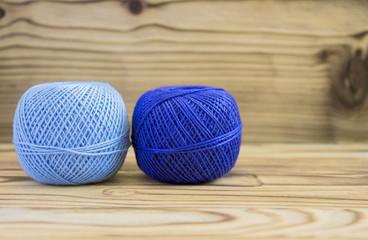 Blue balls of cotton yarn for knitting, crochet