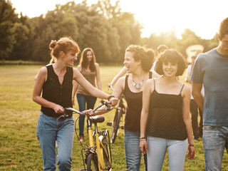 large group of friends together in a park having fun, back to school