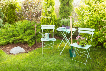 Spring garden - pastel green table with gardening tools