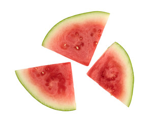 Slices of fresh watermelon on a white background top view.