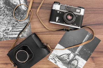 Old camera and two photos