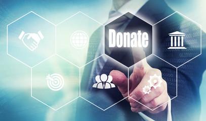 A businessman selecting a Donate Concept button