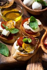 delicious Italian appetizers - various bruschettas, closeup