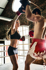 man woman training gym boxing mma ring pads mixed martial arts f