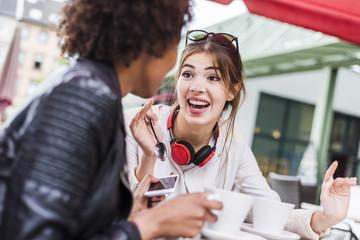 Two best friends talking in a cafe