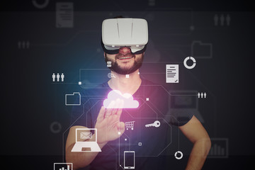 Young man in VR-headset pressing icon on virtual interactive sc