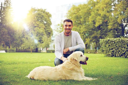 happy man with labrador dog walking in city