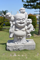 Buddha Statue With Three Little Monkeys