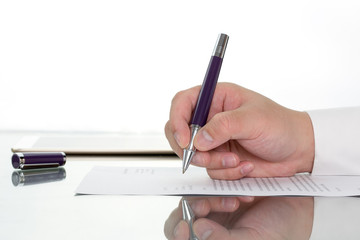 Hand with pen over application form, Businessman signing a contract with ballpoint concept.