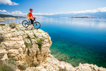 Mountain biker looking at view and sea