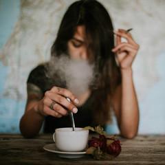 Woman Smoking and Having a Coffee