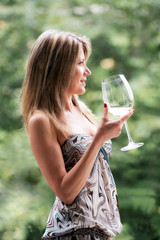 Pretty woman with long hair and wine glass
