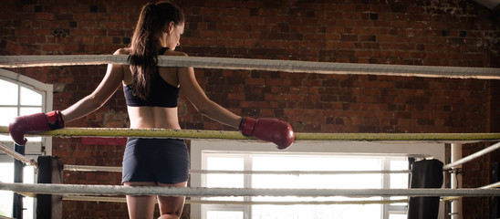 woman training gym boxing mma ring shadow boxing mixed martial a