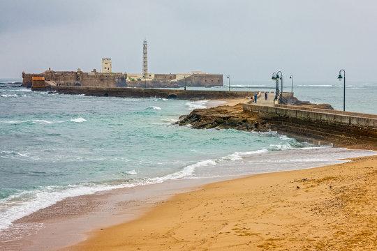 Cadiz, Spain. Beach seascape, Castle of San Sebastian