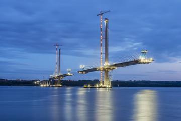 New unfinished bridge lit in Edinburgh after sunset