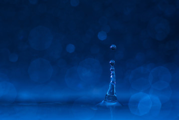 Close up of water drop with bokeh
