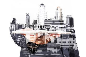 Double exposure of Businessman with Tablet and Modern City Build