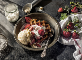 Waffles with strawberries and ice cream in dish