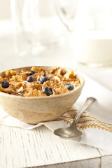 Bowl of breakfast cereal and fruit berries