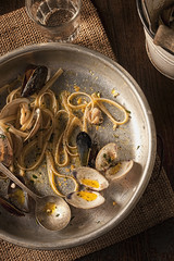 Aerial view of a dish of sea food pasta leftovers