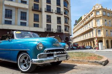 Blue american classic car on Parque Central in Havana, Cuba