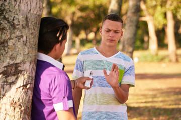 Teenagers Smoking Boy Refusing To Smoke E-cig