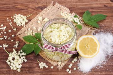 Elderberry flowers and ingredients for preparing fresh healthy juice on rustic board