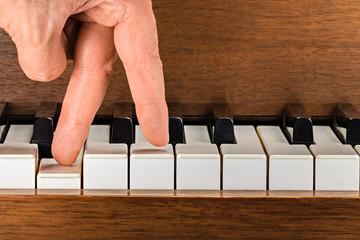 Fingers walking down a keyboard.