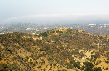 The mountains and hills near Los Angeles (USA). The mountainous landscape. The little houses in the mountains.