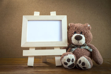 Teddy bear  with wooden frame