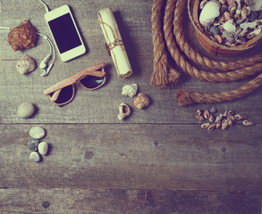 Travel items on wooden table. Summer time sea vacation background