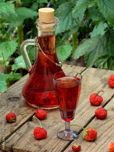 """homemade strawberry liquor on a wooden background"""" Stock photo and ..."""