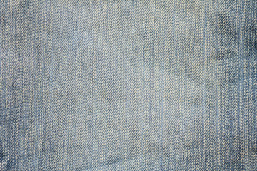 Closeup denim jeans texture. Stitched textured blue denim jeans background. Old grunge vintage denim jeans. Denim jeans fashion design.