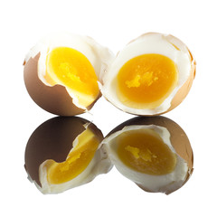 Reflection Boiled egg half cut with eggshell