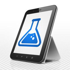 Science concept: Tablet Computer with Flask on display
