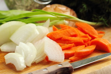 Sliced onion and carrot on chopping board