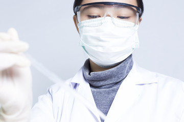 Woman Sciencetist: Researcher Holding at a Liquid Solution on Is