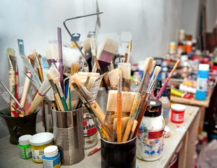 Brushes and paints in the artist's Studio.
