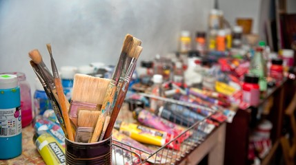 artist's Studio. Bunch of paintbrushes closeup, selective focus.