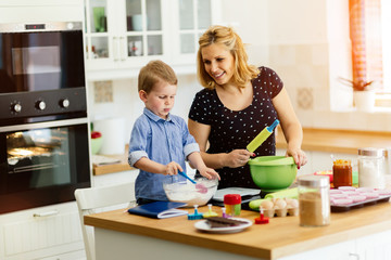 Mother and child preparing cookies