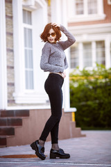 Fashion hipster cool girl in sunglasses. urban background,fashion look