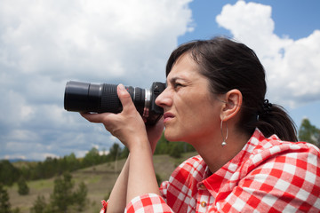 young woman outdoor photographer