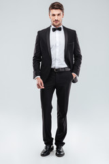 Confident attractive young man in tuxedo