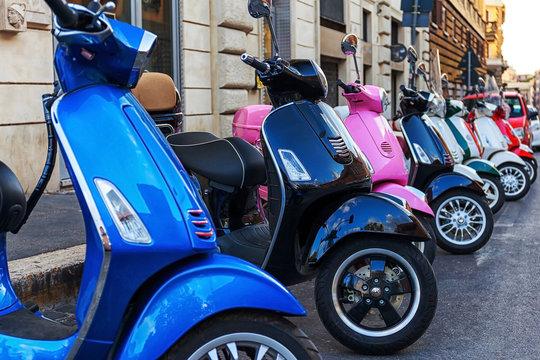 multi-colored scooters vespa