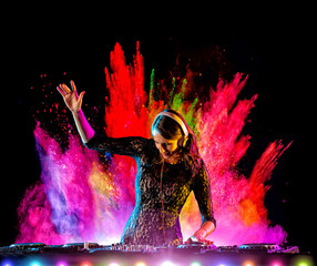 Dj girl mixing electronic music with color powder