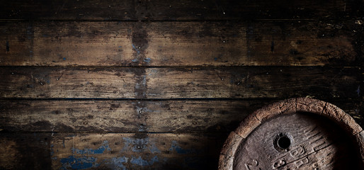 Old oak beer barrel on an old wooden wall banner