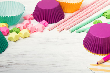 Colorful paper straws, stars and cupcake cups