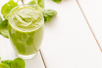 Absolutely Amazing Tasty Green Avocado Shake, Made with Fresh Avocados, Banana, Lemon Juice and Non Dairy Milk (Almond, Coconut) on Light White Wooden Background, Raw, Vegan Drink Conception, Close-up