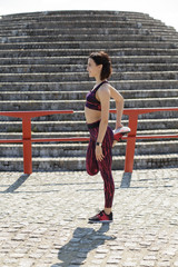 Sporty woman stretching outdoor