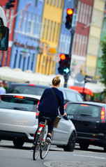 Female bicyclist on the street